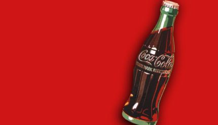 Coca-Cola bottle on red background